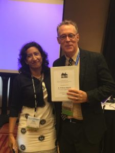 Incoming Division Head Indira Somani (l) thanks Bill Silcock for his leadership in planning and executing the Division's successful 2016 AEJMC conference.