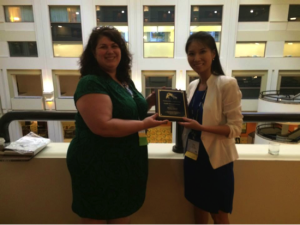Outgoing Head Amanda Weed (left) presented Jieun Chung (right) the Guido Stempel Award.