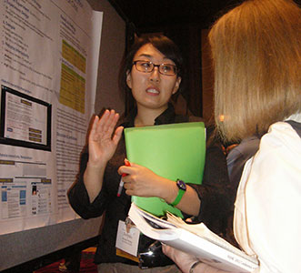 A University of Florida student explains her posterin 2013.