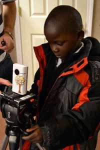 student works with camera