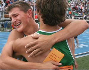 two athletes embrace